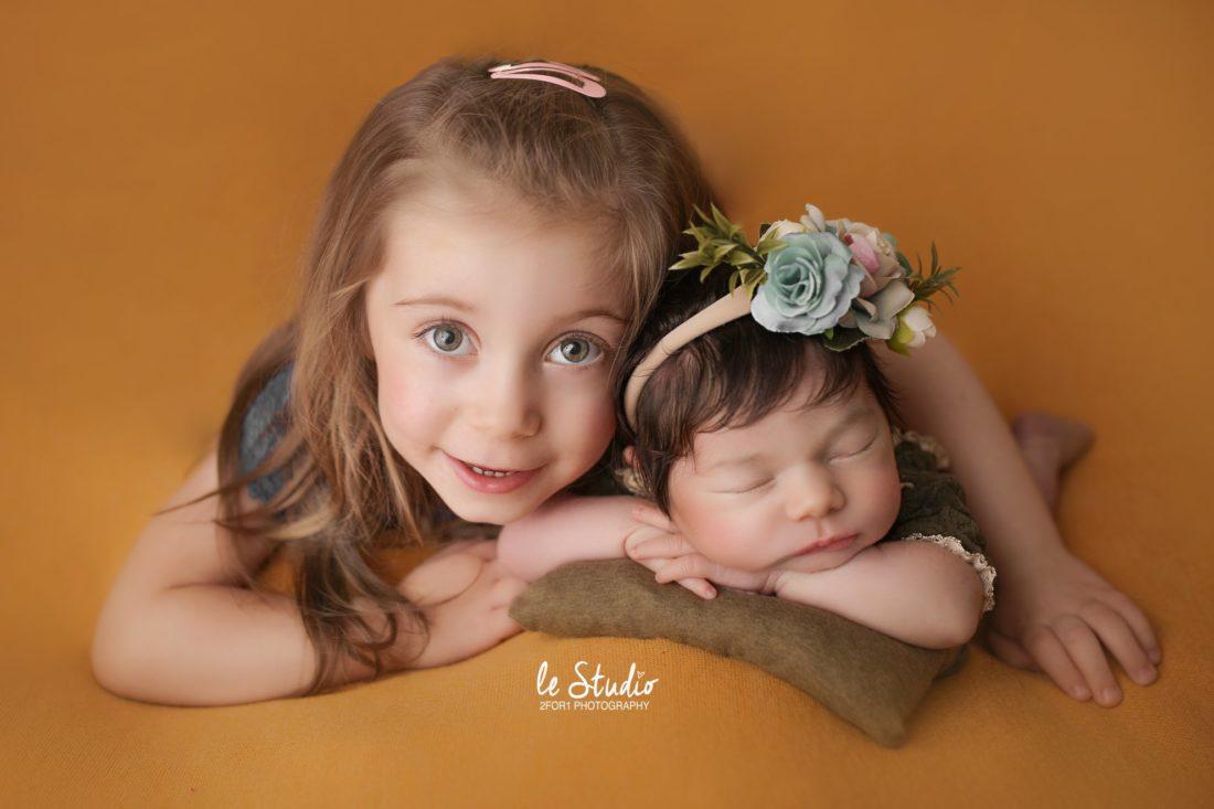 photo grande soeur et bébé